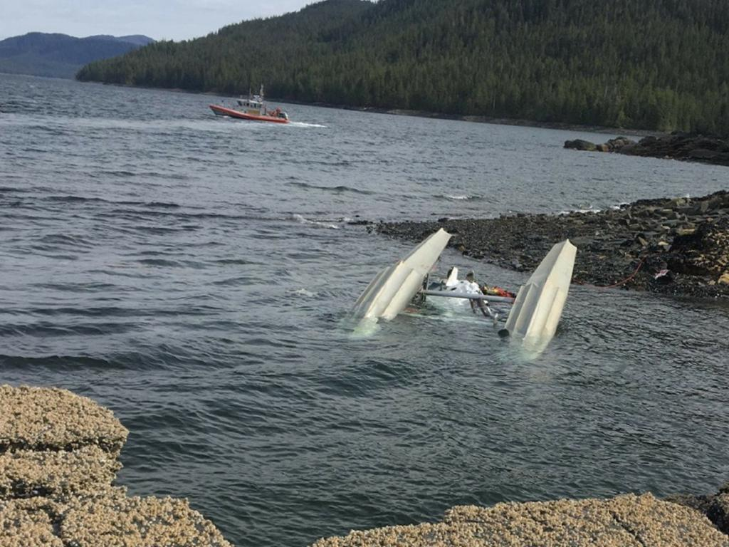 US Coast Guard crews respond to a mid-air collision between two seaplanes in Alaska. An Australian cruise ship passenger has died and 10 Americans are injured. Picture: AAP