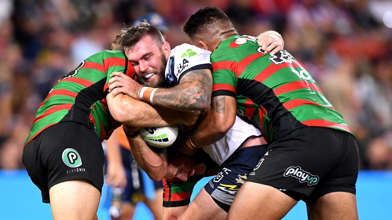 Kyle Feldt of the Cowboys is tackled during the round nine NRL match between the South Sydney Rabbitohs and the North Queensland Cowboys at Suncorp Stadium on May 12, 2019 in Brisbane, Australia. (Photo by Bradley Kanaris/Getty Images)