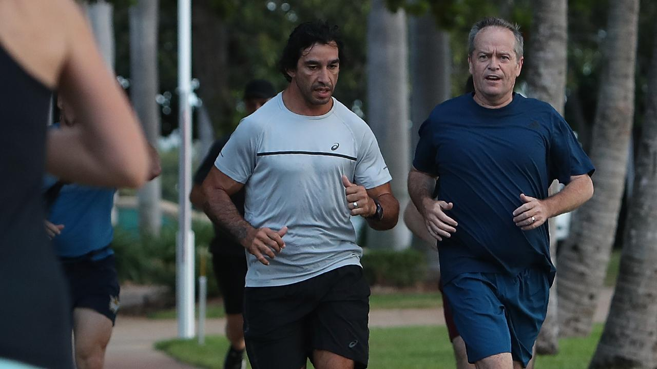 Shorten and former NRL player Jonathan Thurston on a morning run in Townsville, during the election campaign. Picture: Kym Smith