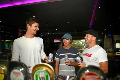 LAST DRINKS: Ben Campbell and Mick Sell and Steve Stockley share a Coolum Centenary Ale.