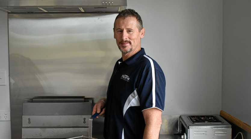 CHIPPING IN: Stanthorpe Gremlins RLFC president Lindsay Adams fries up a storm.