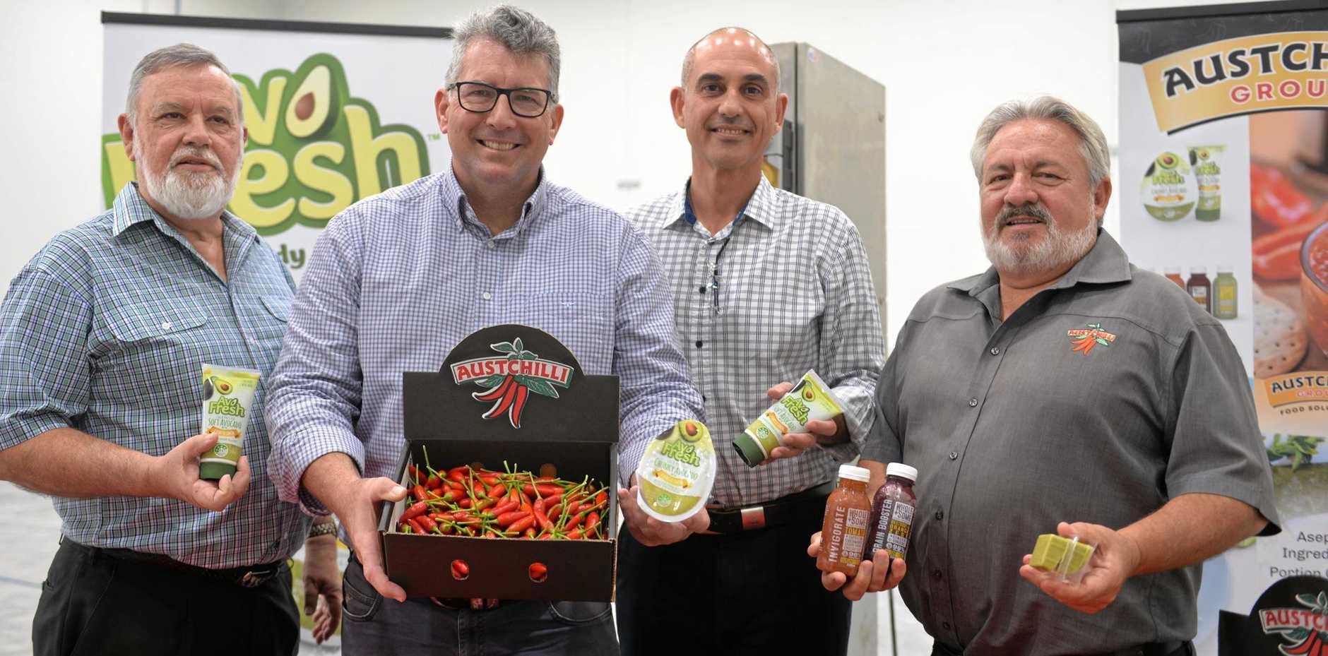 HOT PRODUCE: Ian Gaffel of Austchilli, Member for Hinkler Keith Pitt, Rob Pafumi Austchilli general manager of innovation, marketing and sales and Austchilli managing director David De Paoli in the nearly complete Austchilli expansion facility.