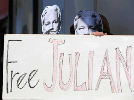 Julian Assange protesters set up outside Federal Richmond MP Justine Elliot's office at Tweed Heads.