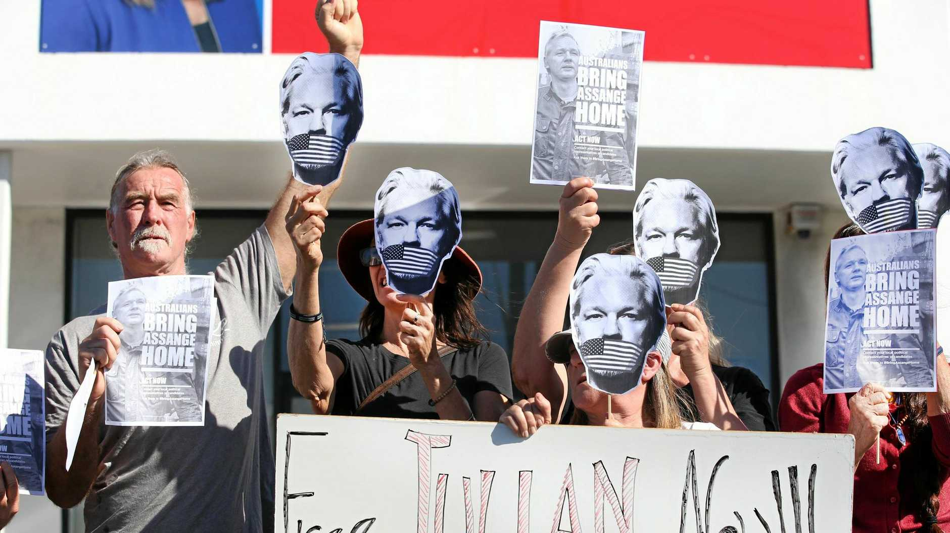 Free Julian Assange organiser Dean Jeffrey's (left) with his fellow protesters.