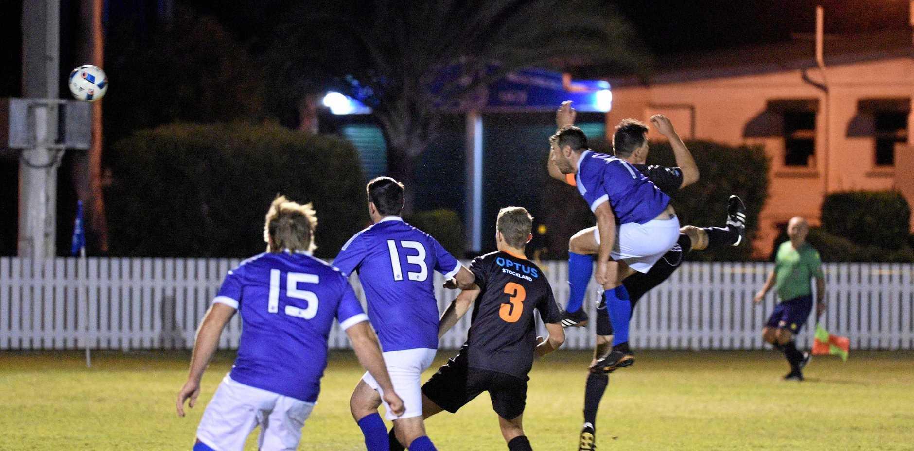Anthony Mollee (7) heads the ball towards the goal. Sunbury v United Park Eagles (UPE) at Maryborough Cricket Club.