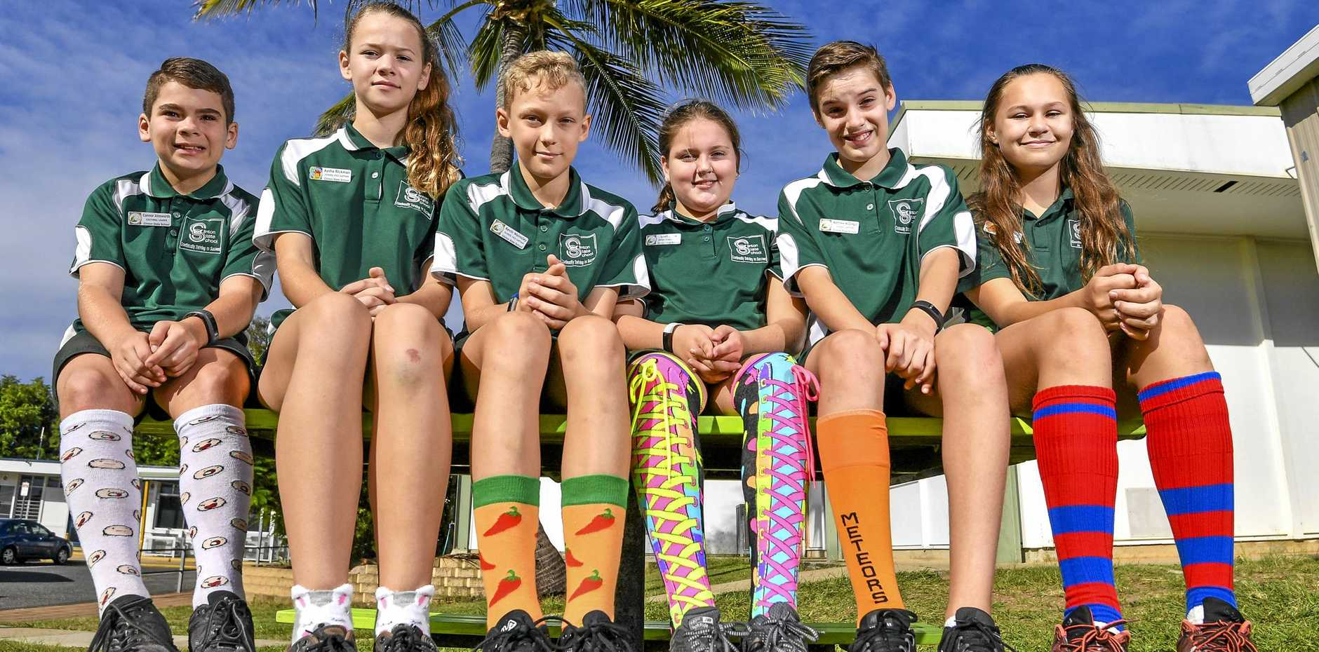 Connor Ainsworth, Aysha Rickman, Kevin Walmsley, Leah Shaw, Matthew McGregor and Kiesha Willis from Clinton State School who are hosting a crazy sock day on 17 May 2019 to raise money for charity.