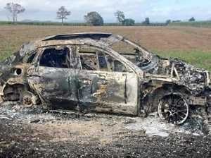 Luxury car found torched
