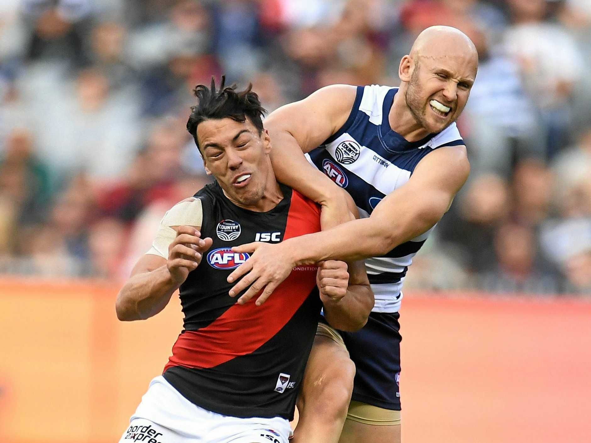 Ablett hits Dylan Shiel high during their Round 7 match. (AAP Image/Julian Smith)