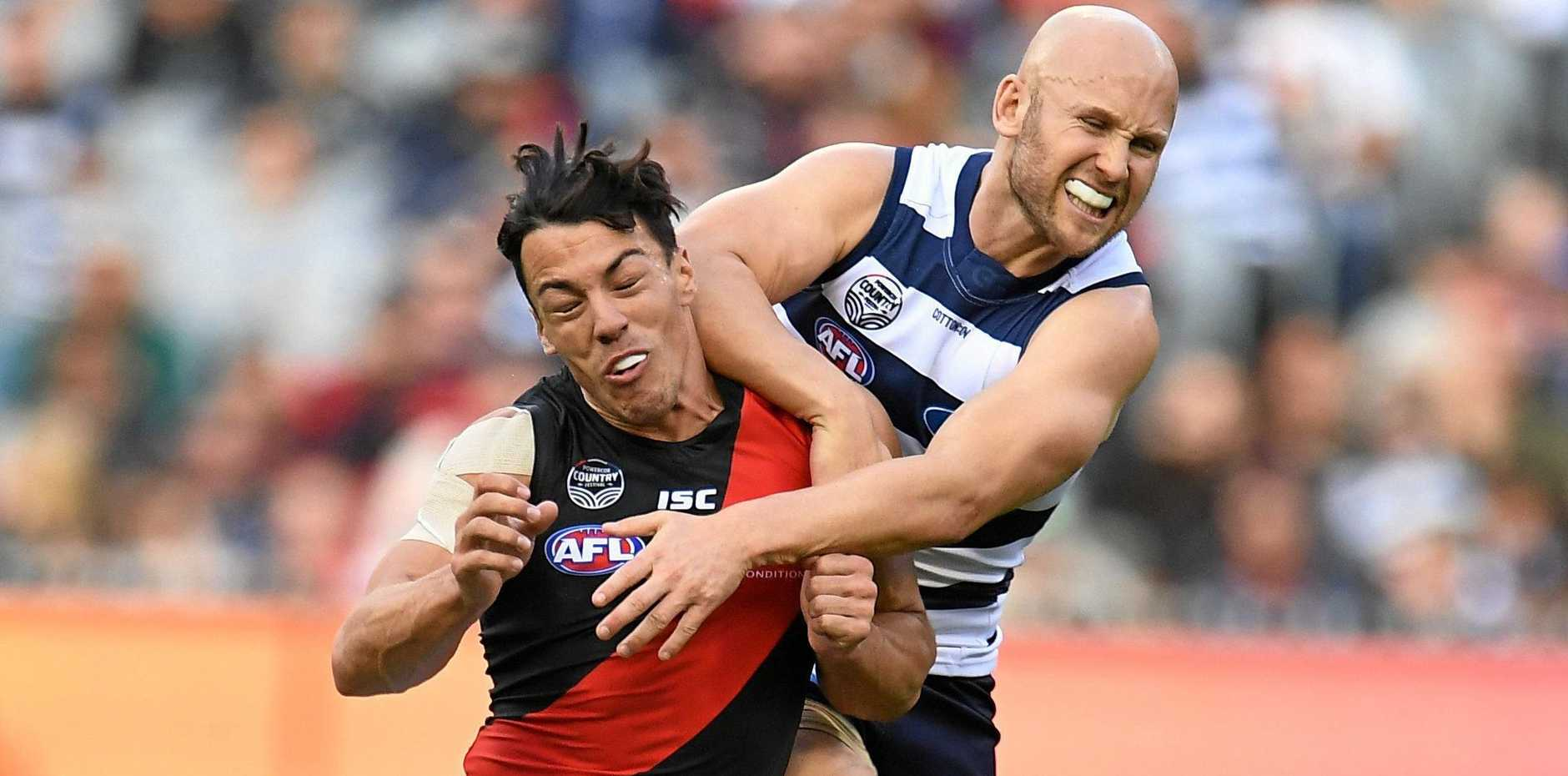 Essendon's Dylan Shiel cops an elbow from Geelong's Gary Ablett at the MCG on May 5.  Picture: Julian Smith/AAP