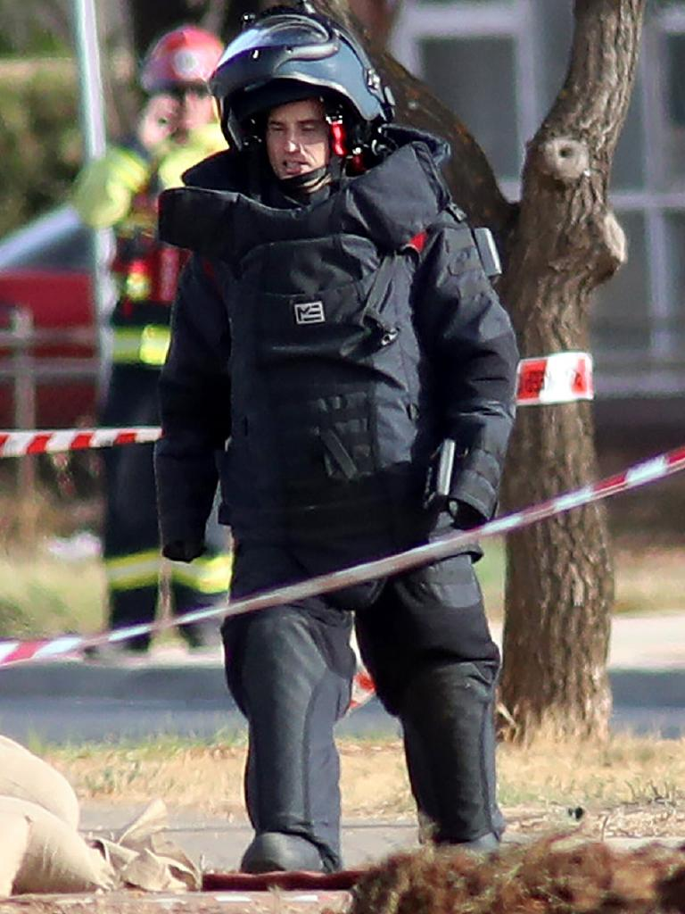 A bomb squad officer at the Davoren Park home, as police prepared to detonate the explosives known as 'Mother of Satan'. Picture: AAP / Kelly Barnes