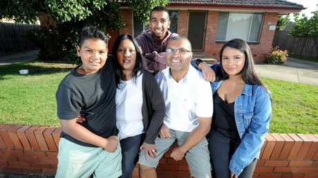 Darren and Michelle Arandez with their kids Jerome (18), Tristan (12) and Shae (21) at the investment property they own in St Albans. Picture: Andrew Henshaw