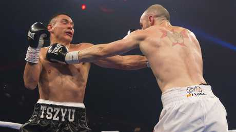 Joel Camilleri lands a punch on Tim Tszyu during their super welterweight title bout. Picture: AAP
