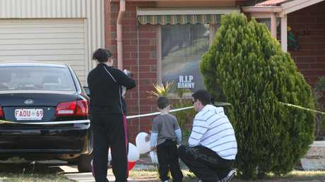 Grieving relatives leave tributes to Beverley Hanley at the crime scene after her body was discovered in her Elizabeth North home.