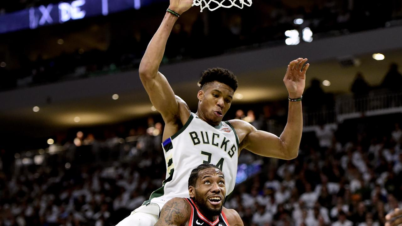 Toronto Raptors forward Kawhi Leonard is fouled by the Milwaukee Bucks' Giannis Antetokounmpo in game one of the NBA Eastern Conference finals in Milwaukee. Picture: Frank Gunn/The Canadian Press/AP