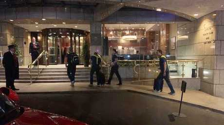 Australian players arrive at their London hotel.