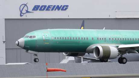 A Boeing 737 MAX 8 aeroplane built for India-based Jet Airways lands from a test flight at Boeing Field in Seattle. Picture: AP/Ted S. Warren