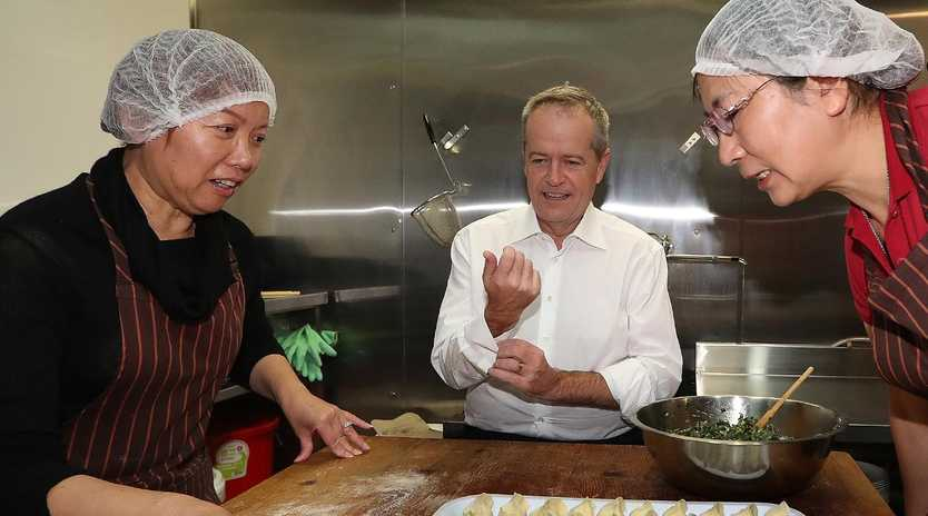 Opposition Leader Bill Shorten making chive and pork dumplings while on a visit to Xibay Little Lamb in Burwood, Sydney. Picture: Kym Smith