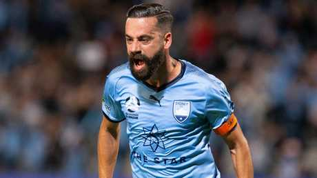Alex Brosque celebrates his volleyed goal for Sydney FC against Melbourne Victory on Sunday night. Picture: AAP