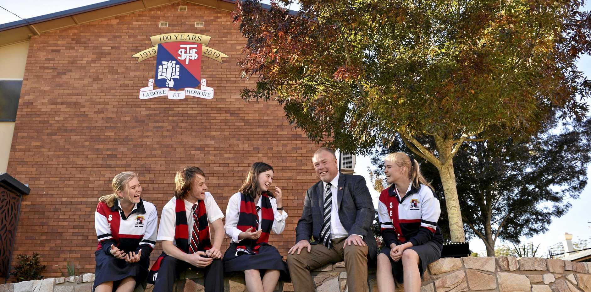 100 YEARS OF EXCELLENCE: Toowoomba State High School students (from left) Nikkia Campbell, Eliot Argus, Adelaide Cool and Jordann Campbell with principal Tony Kennedy in the new centenary courtyard as the school celebrates 100 years.