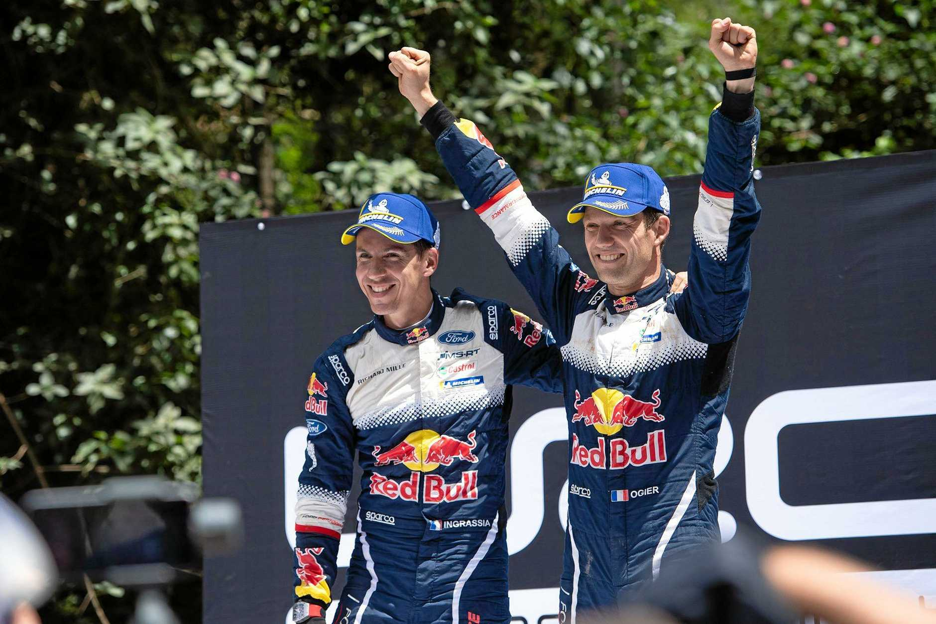 COMING BACK: 2018 World Champion Sebastien Ogier and his co-driver Julien Ingrassia celebrate on the podium. The rally is returning to the Nambucca Shire in 2019.