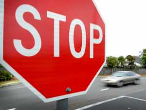 How long should you wait at a stop sign for?