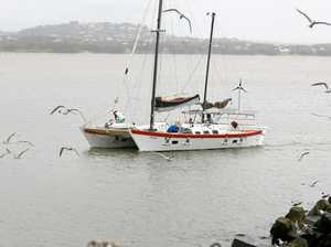 Catamaran beached off Rosslyn Bay after filling with water