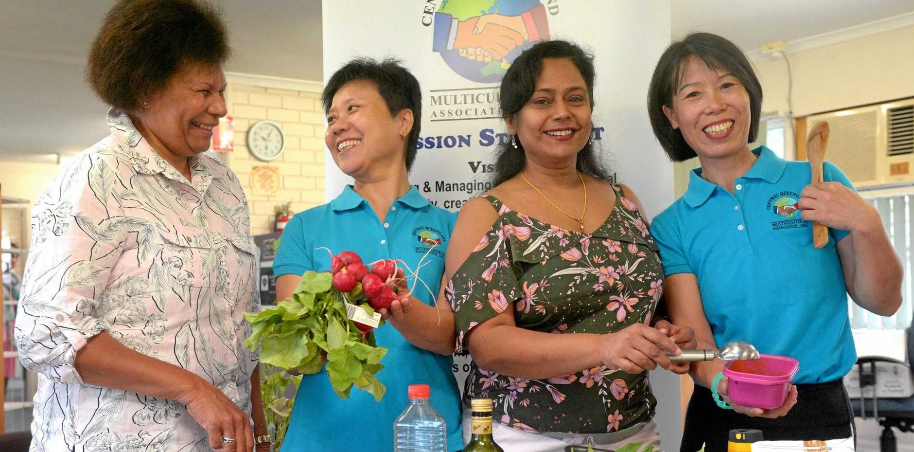 Theresa Stanke, Yngli Zhang, Dheepa Arumuga and Bing Xiong from QCMA prepare for taste of the World at the Showgrounds