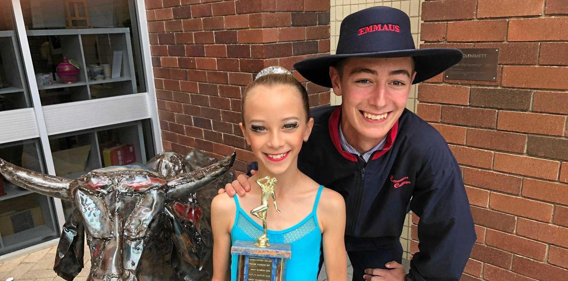 Sienna Westcott wins the Tap Improvisation U10 trophy her brother Mitchell won in 2012.