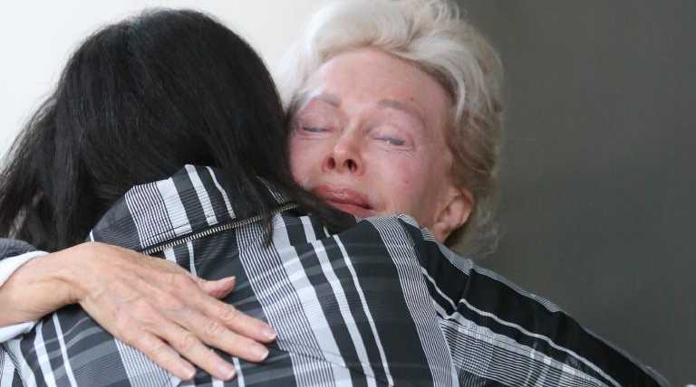 Ms d'Alpuget was comforted by Daily Telegraph journalist Adella Beaini. Picture: John Grainger