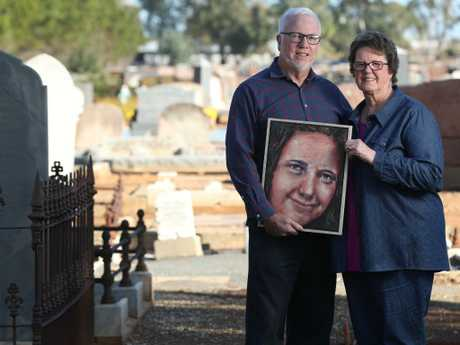Peter and Jeanette Woods with a portrait of Veronica Knight. Picture: Tait Schmaal