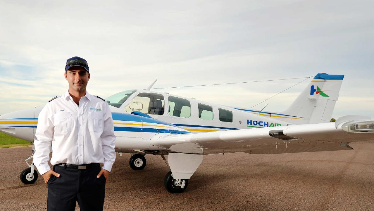 Pilot Josh Hoch accused of pouring contaminants into commercial rivals' aircraft fuel tanks and faking crashes for insurance is contesting the charges.