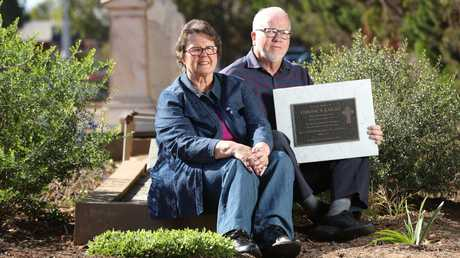 The unofficial foster parents of Truro victim Veronica Knight, Peter and Jeanette woods, at North Brighton cemetery with the new headstone for her grave. Picture: Tait Schmaal
