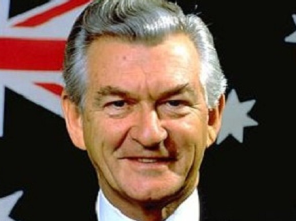 Bob Hawke poses in front of the Australian flag. Picture: Supplied