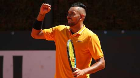 Nick Kyrgios celebrates winning a point against Casper Ruud at the Italian Open on Thursday. Kyrgios has been kicked out of the tournament. Picture: Getty Images