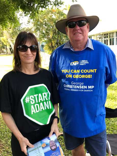 Evelyn Vassallo and Paul Fordyce handing out how to vote cards at Bucasia State School polling station.