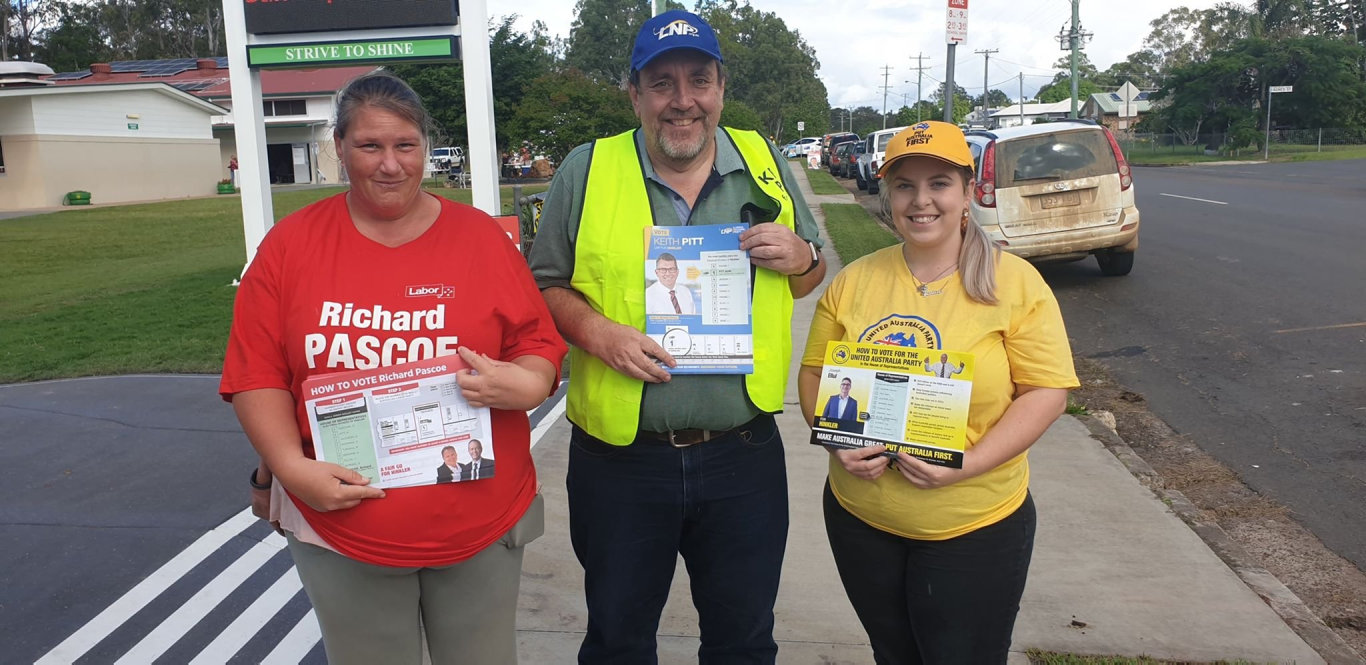 LNP supporter Grant Maw with fellow pamphlet holders - Malinda Rowland for Labor and Jess Dobson for the United Australia Party.