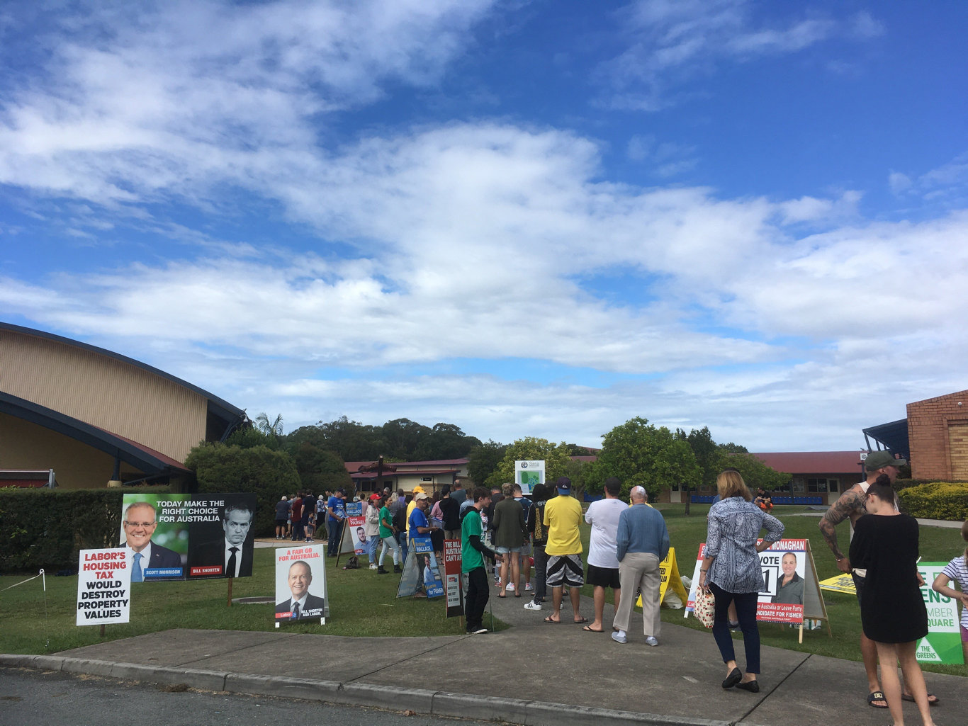 BUSY: The queue is swelling at Siena Catholic College in Sippy Downs this morning and the sausage sizzle is proving a hit.