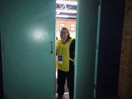An AEC supervisor closes the polling booth at Goonellabah Public School.