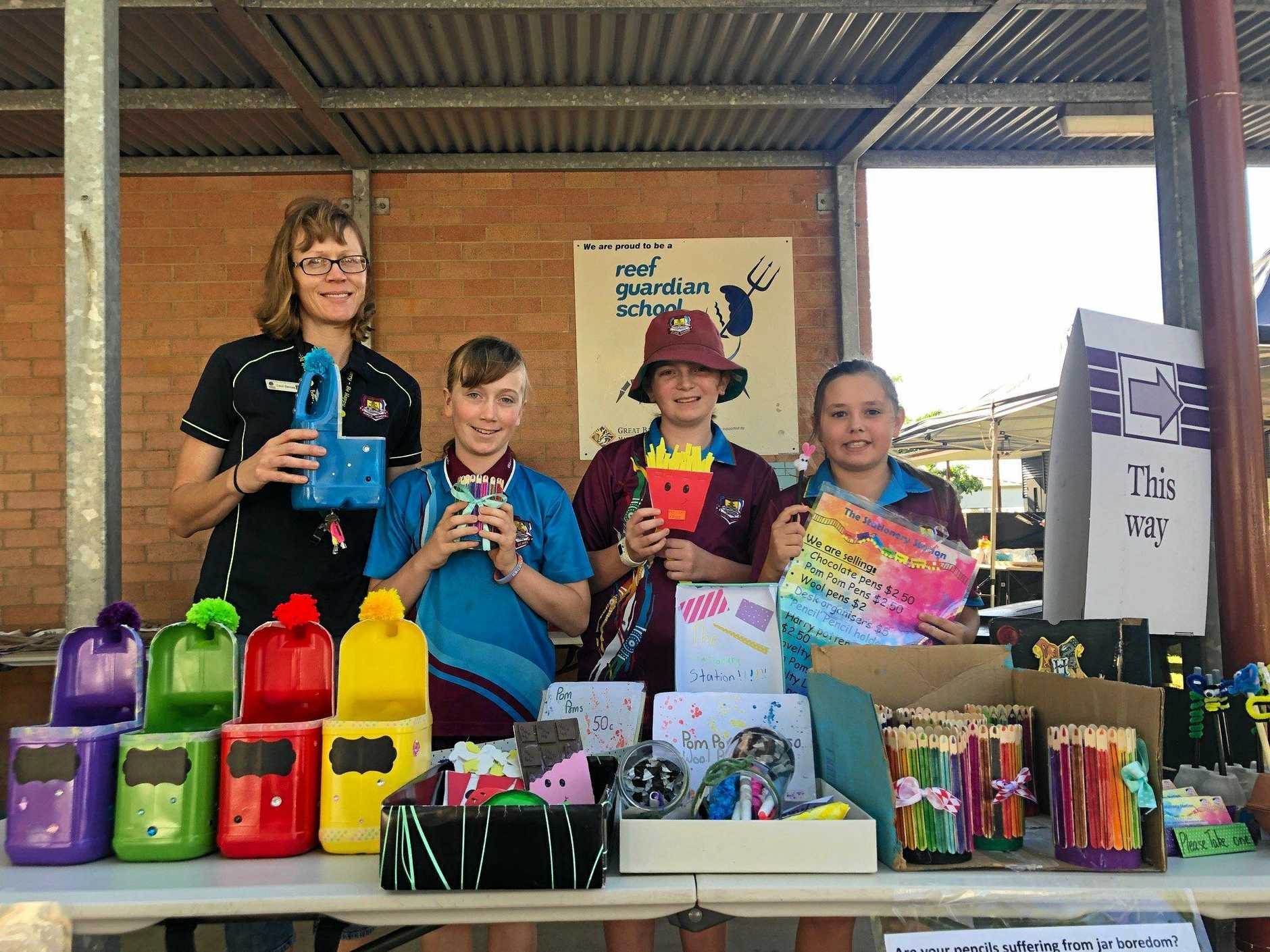 Gladstone Central State School teacher Carol Devney with students Jolene Devney, Caitlin Price and Tegan Albeck at the earlier preneuer markets on election day 2019.