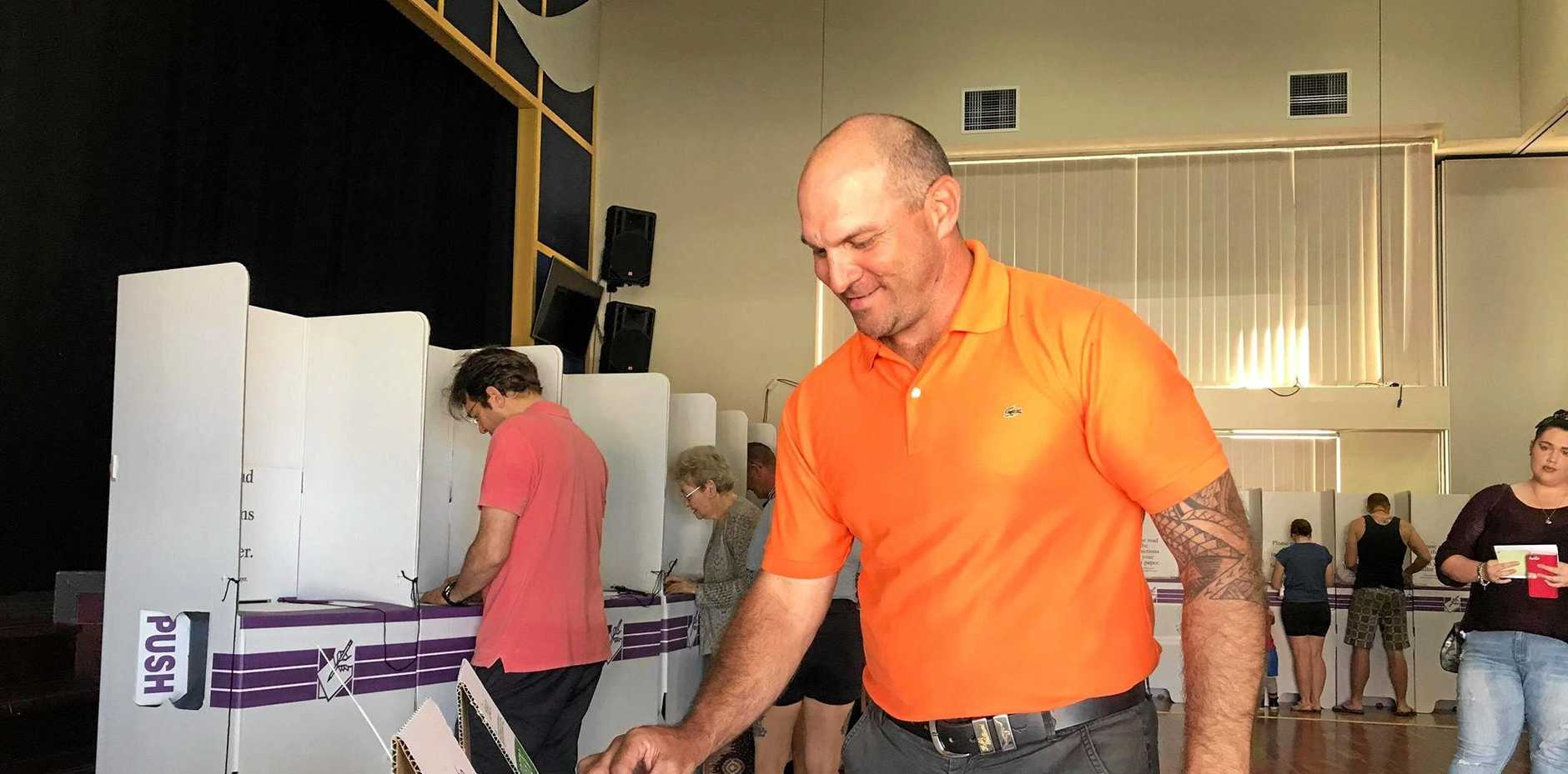 STRONG PERFORMANCE: One Nation's Wade Rothery placing his vote at the North Rockhampton State High School before placing third in Capricornia in the federal election.