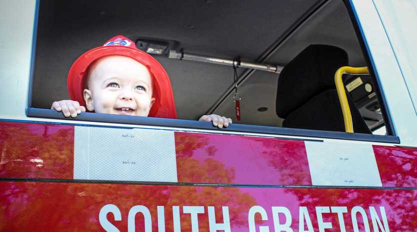 Luke Welch's son, Aston, considers following his father's footsteps in a South Grafton fire truck.
