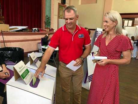 Wide Bay's Labor candidate Jason Scanes casts his vote with wife Jackie.