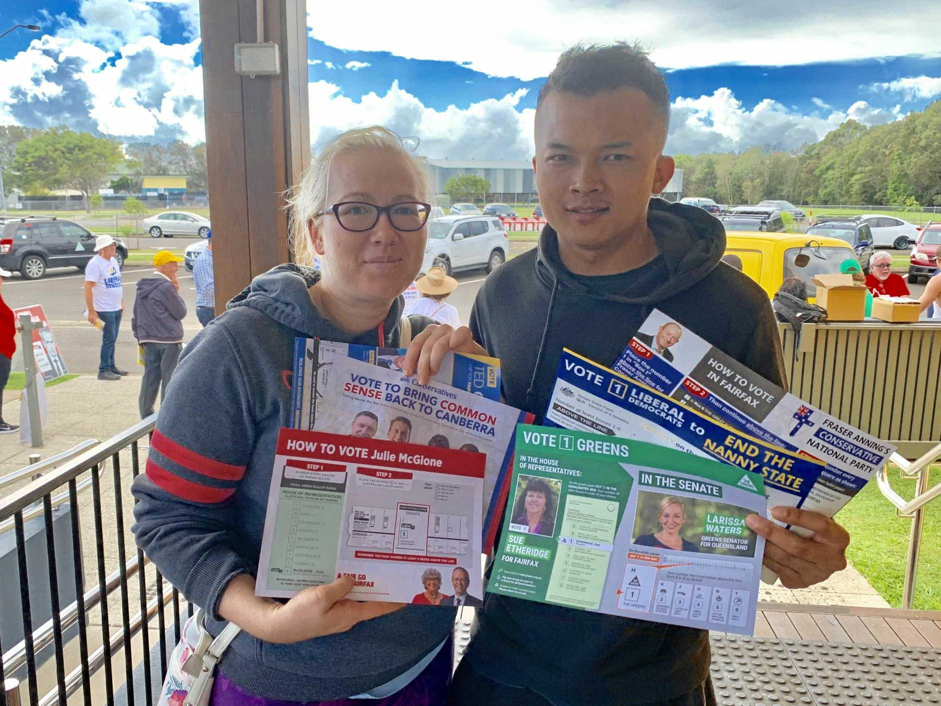 VOTING: Theresa Miller and Sirichai Noithanom thought the number of handouts were unnecessary as they prepared to vote at Mountain Creek State School.