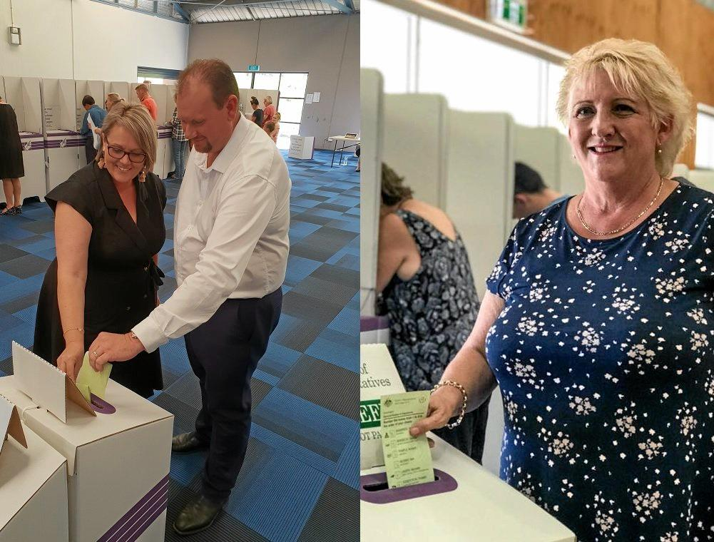 LEADING CONTENDERS: Labor's Russell Robertson and his wife Denise and LNP's Michelle Landry cast their votes in the battle for the seat of Capricornia.