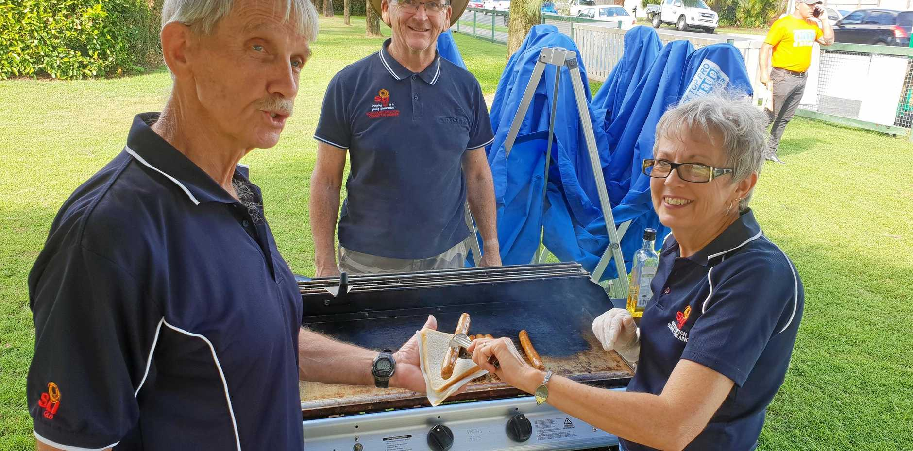 REINFORCEMENTS REQUIRED: Nev Thwaite, Bill Tomsen and Leslie Scott needed more sausages after their sausage stall at North Rockhampton High School ran out of supplies today.