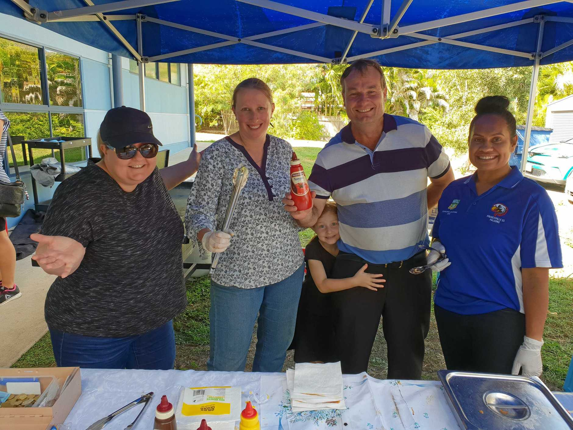 SAUSAGE SHORTAGE: Frenchville Primary School's fundraising efforts went better than expected, with Jacinta Delalande (left), Henrike Hilse, Shane Latcham and Anna Umba selling out of sausages by lunchtime today.