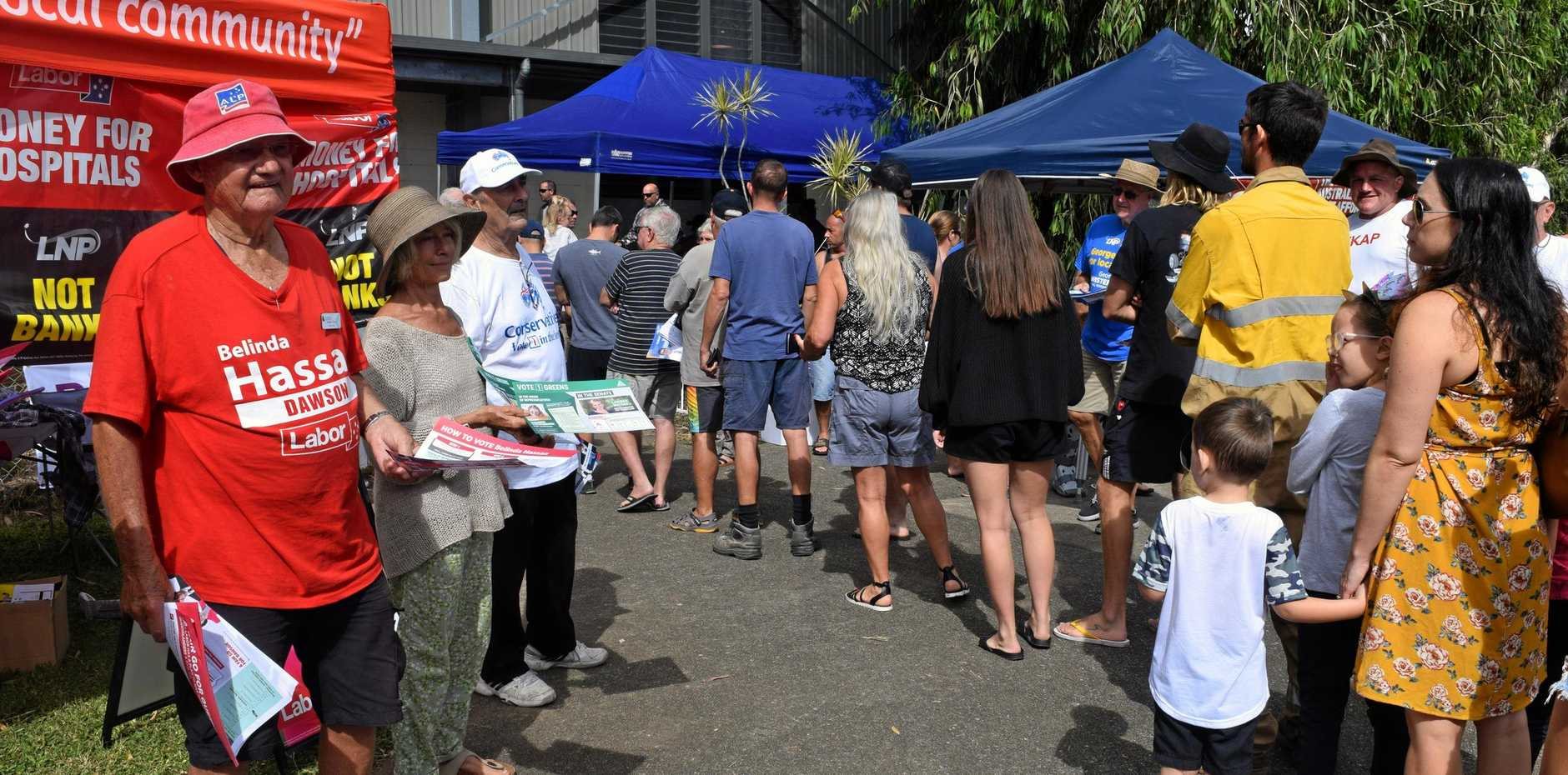 People wait in line to vote in the federal election at Cannonvale.