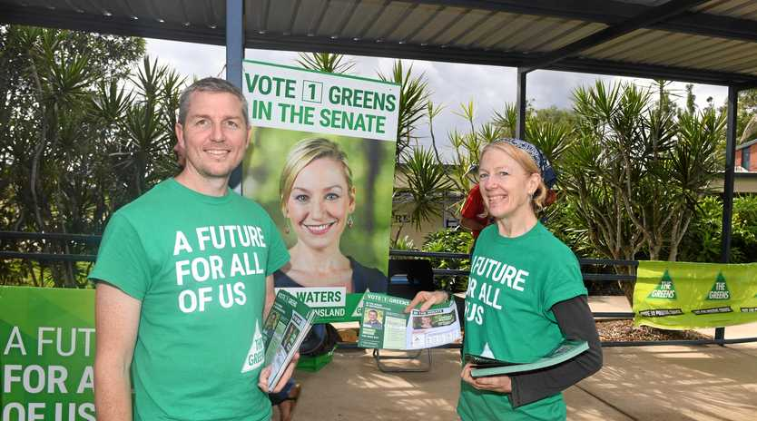 The Greens Wide Bay candidate Daniel Bryar with volunteer Lauren Granger-Brown at the Gympie South State School polling booth on Election Saturday.