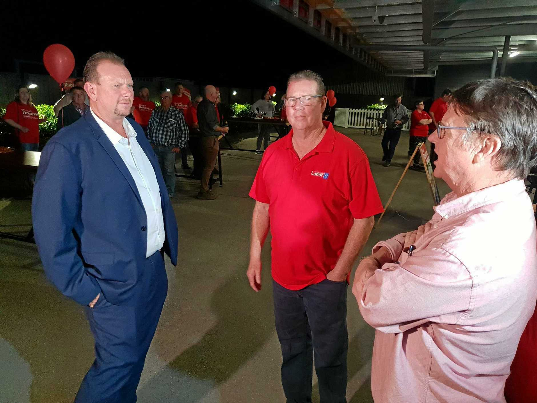 LABOR HEARTBREAK: Labor's candidate for Capricornia Russell Robertson commiserated with Labor's Rockhampton MP Barry O'Rourke and former MP Robert Schwarten.