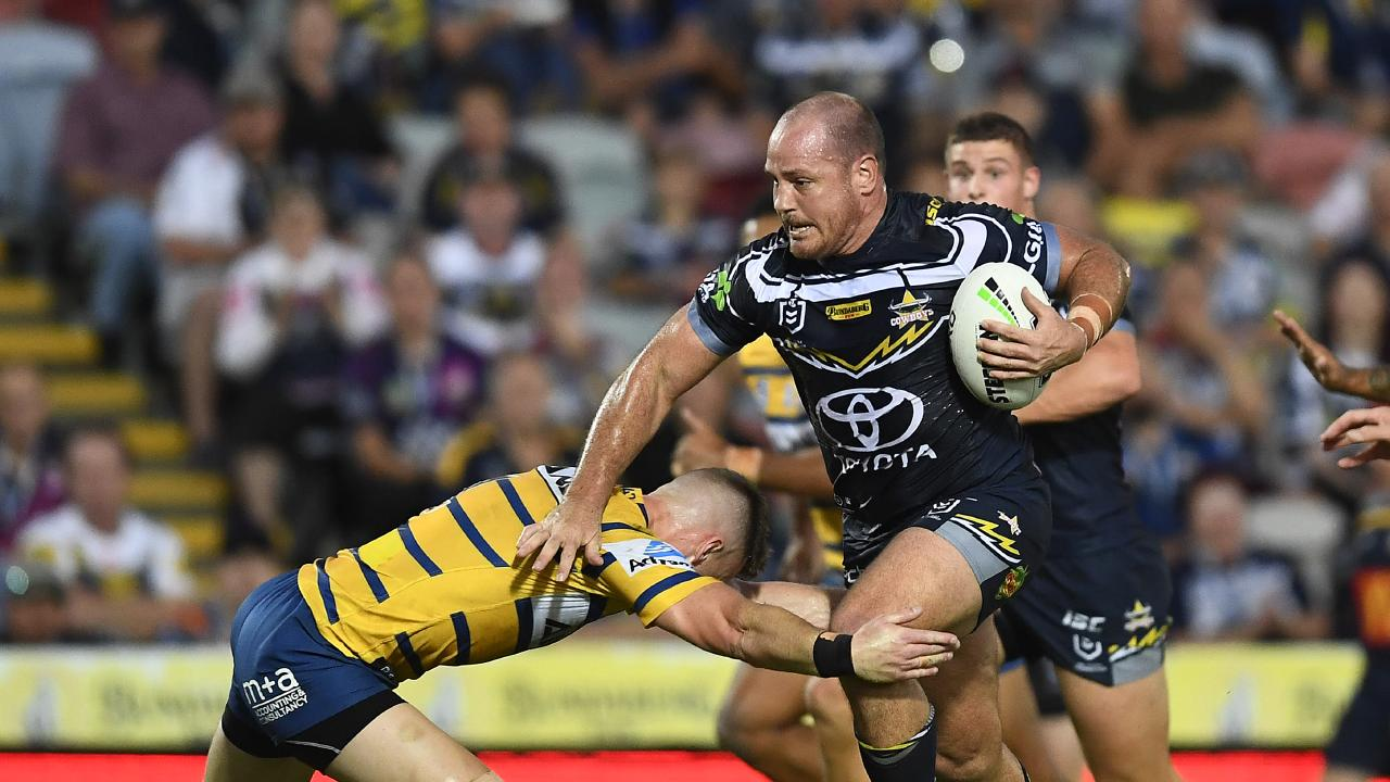 TOWNSVILLE, AUSTRALIA - MAY 18: Matt Scott of the Cowboys makes a break during the round 10 NRL match between the North Queensland Cowboys and the Parramatta Eels at 1300SMILES Stadium on May 18, 2019 in Townsville, Australia. (Photo by Ian Hitchcock/Getty Images)